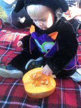 Hollowing out the pumpkins is a great sensory activity.